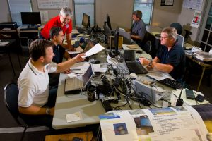 ASPECT Team members process the day's data from overflights of BP Oil Spill in the Gulf of Mexico. Left to right, Paul Kudarauskas, John Cardarelli, Bob Kroutil, Tim Curry, and Team Leader, Mark Thomas. USEPA Photo by Eric Vance